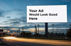 Nighttime Billboard with the words 'Your Ad Would Look Good Here' on it
