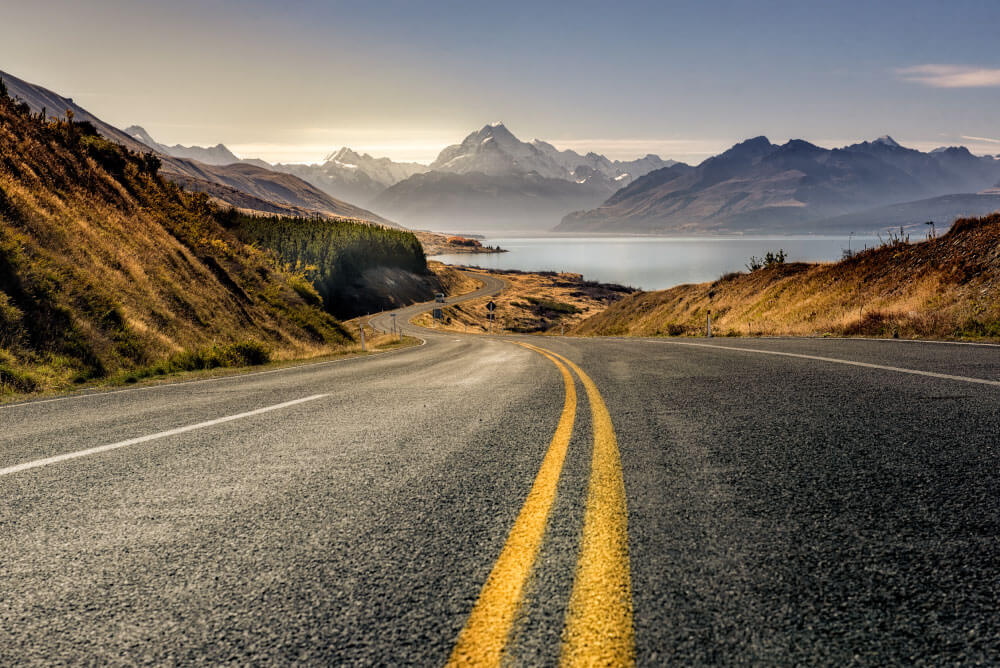 Image of a road with a mountain in the distance