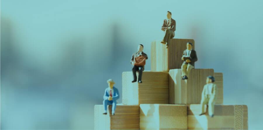 figurines on building blocks