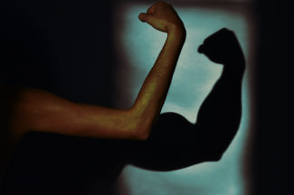 a weak arm in front of a strong arm shadow